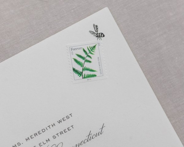 blossom deary wedding envelope bee carrying stamp detail