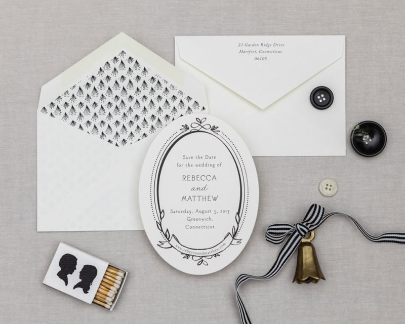 oval card with lined envelope black and white wedding suite