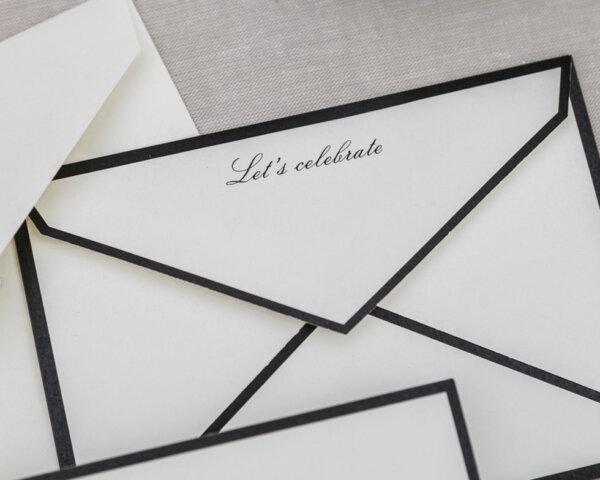 black and white let's celebrate envelope