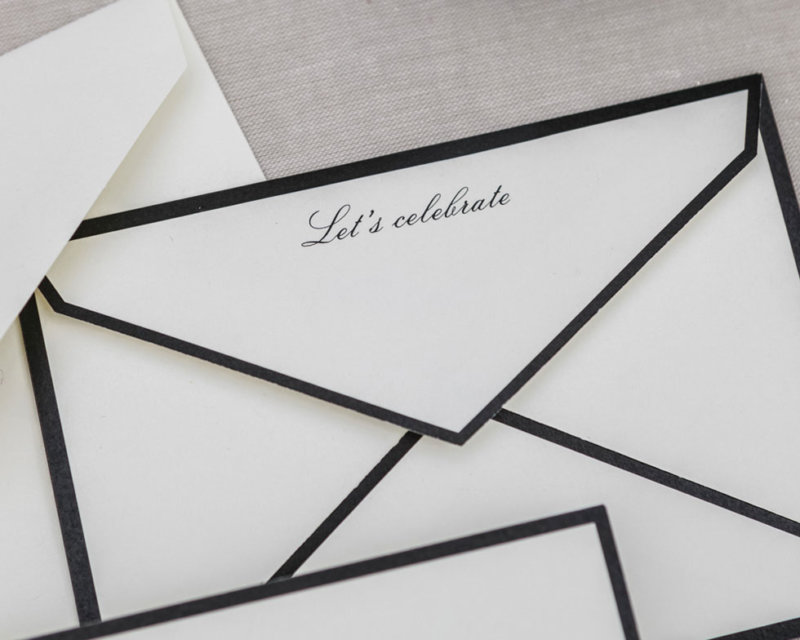 black and white let's celebrate envelope