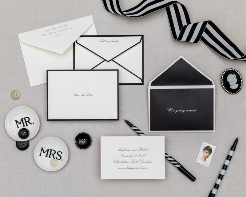 series of four black and white nesting envelopes with save the date card